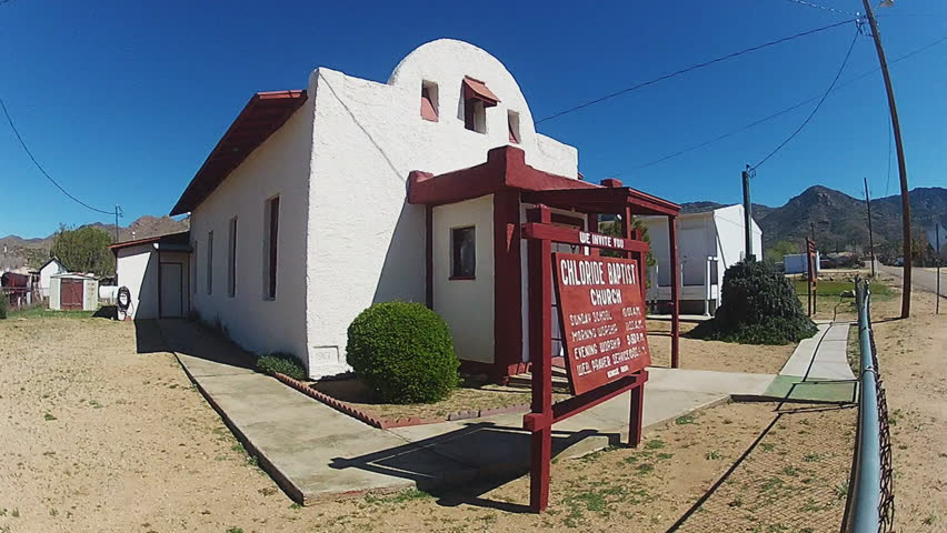 CHLORIDE, AZ/USA - June 16, 2015: Shot of a small Baptist church in the historic town of Chloride Arizona. An old West style building provides the locals a place of worship. - HD stock video clip