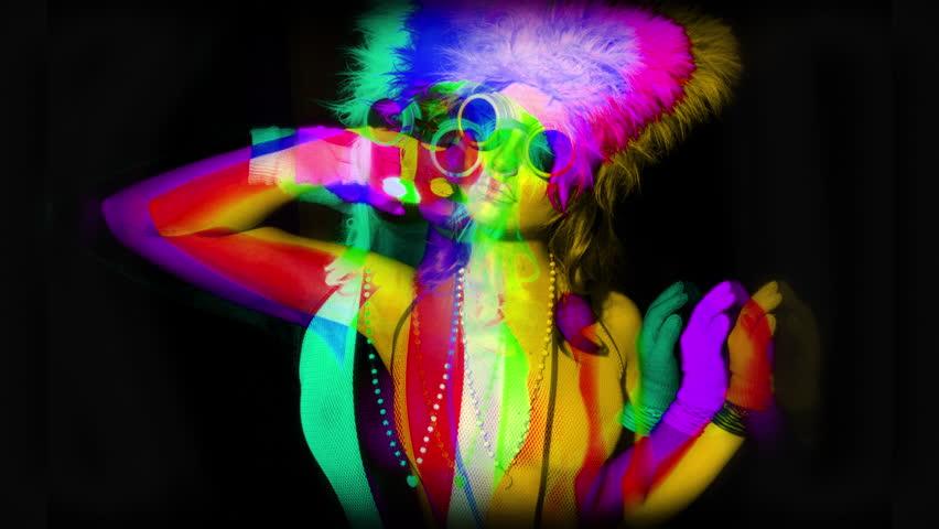 4k sequence of fantastic shots of different sexy cyber raver dancer babes filmed in fluorescent clothing under UV black light