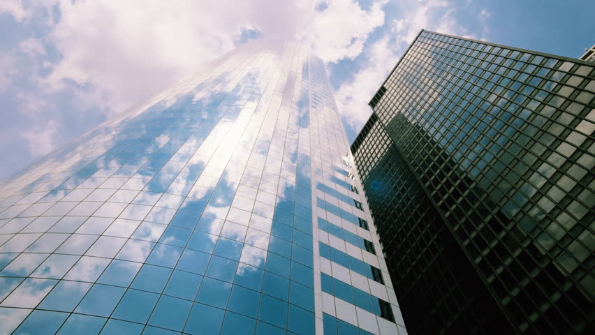 Sky and clouds reflected on skyscrapers facades in New York City - 4K stock footage clip