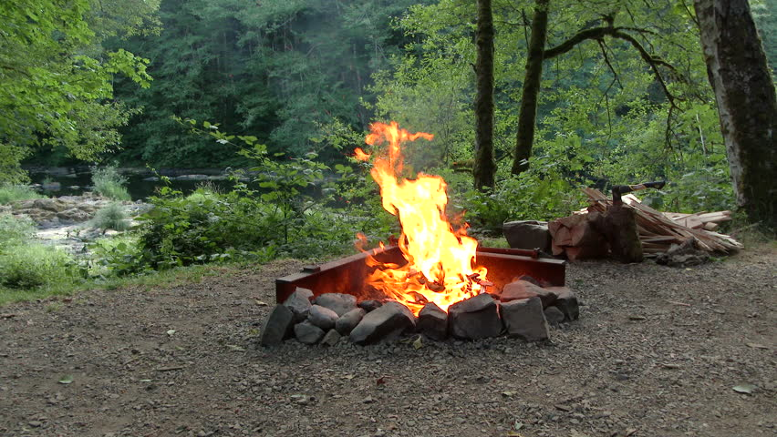 Large Campfire Burning In Fire Pit At Campground In The