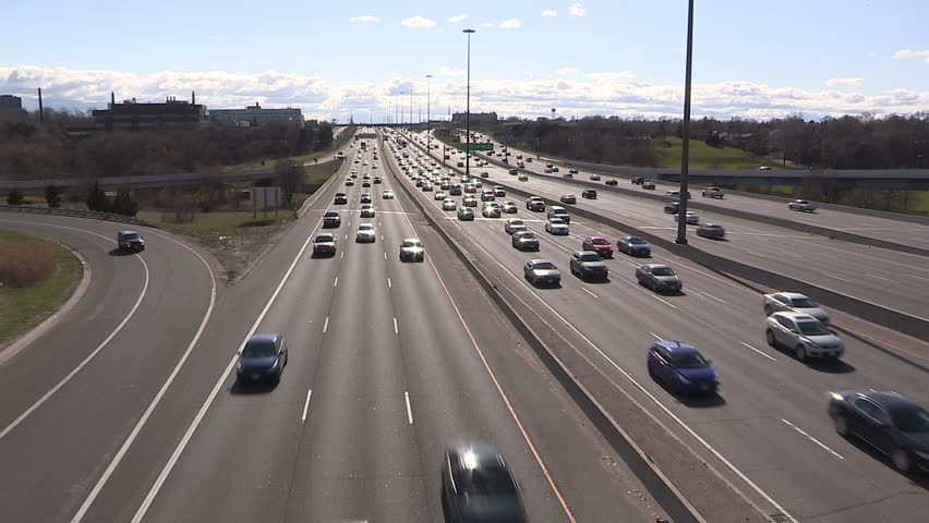 Toronto, Ontario, Canada - May 2015 - Toronto highway traffic jam at rush hour with sun reflecting off cars - HD stock video clip