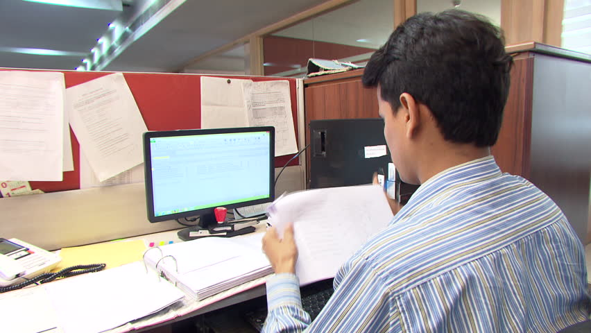 Shot of indian men working in the office new delhi india hd stock