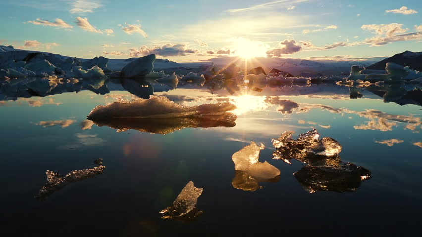 Icebergs Lighting up like Crystals During Sunrise in Glacier Lagoon. Aerial Shot. Iceland. | Shutterstock HD Video #10811123