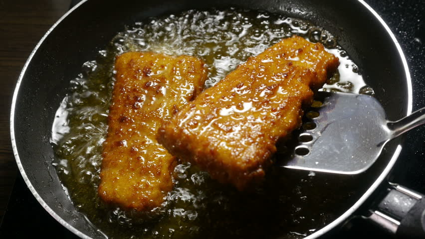 Fish corners cooking in a frying pan fish corners for What is the best oil for frying fish