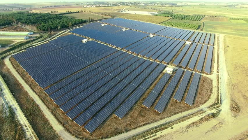 Aerial:  Photovoltaic solar units. Renewable energy system. Scenic beautiful shot