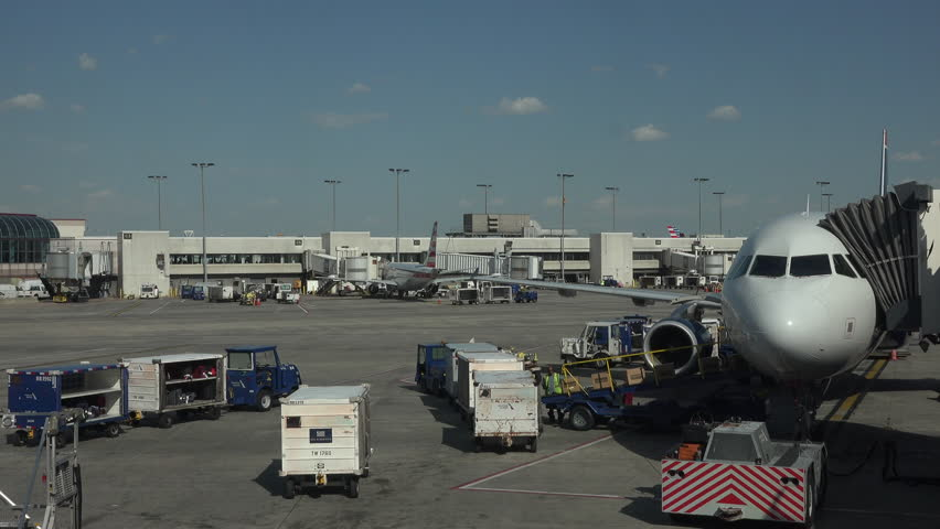 WASHINGTON, DC - APR 2015: Aircraft empty cargo Dulles International Airport ramp fast timelapse 4K. Busiest airport in metropolitan area. serves over 21 million passengers per year. Travel. - 4K stock footage clip