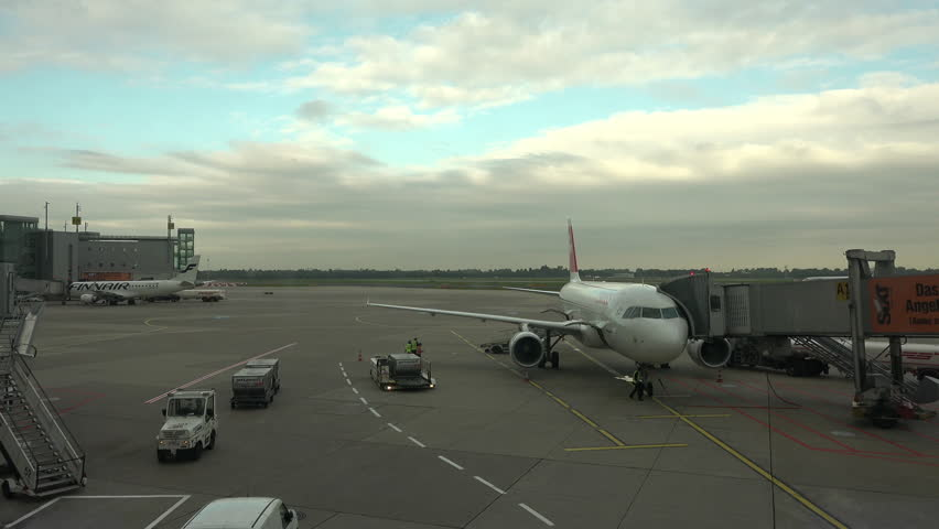 DUSSELDORF, GERMANY - SEPT 2015: Dusseldorf Germany airport aircraft ramp 4K. 20 million passengers a year. International airport, the third largest airport in Germany. Passenger terminals.