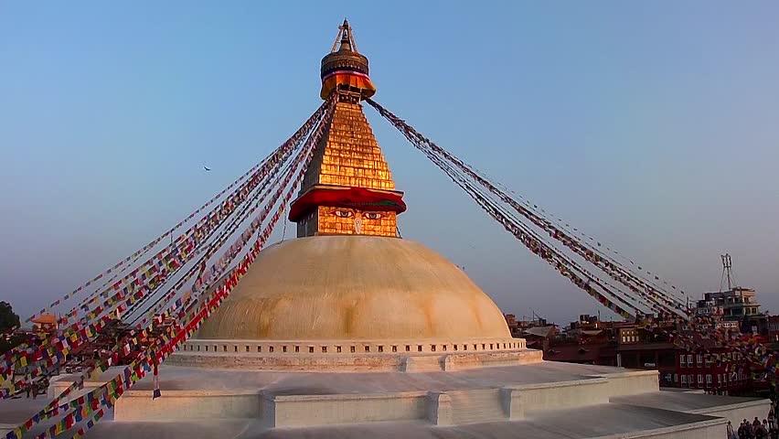 KATHMANDU, NEPAL - NOVEMBER 2, 2013: The Boudhanath Stupa just before sunset on November 2, 2013 in Kathmandu, Nepal. The stupa survived the massive earthquake of 25 April, 2015. - HD stock footage clip