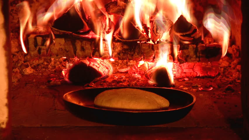 Baking bread in a traditional oven