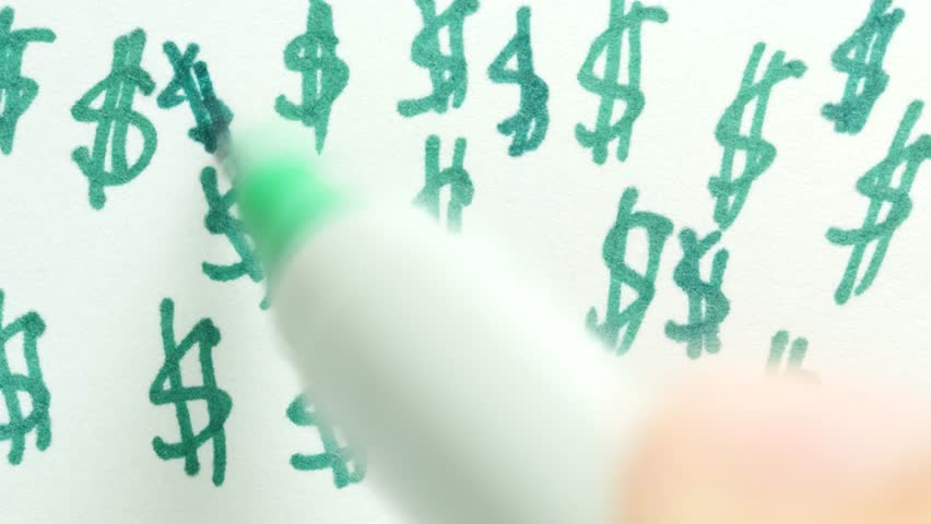 Drawing dollar signs ($$$$) in green on a sheet of paper.