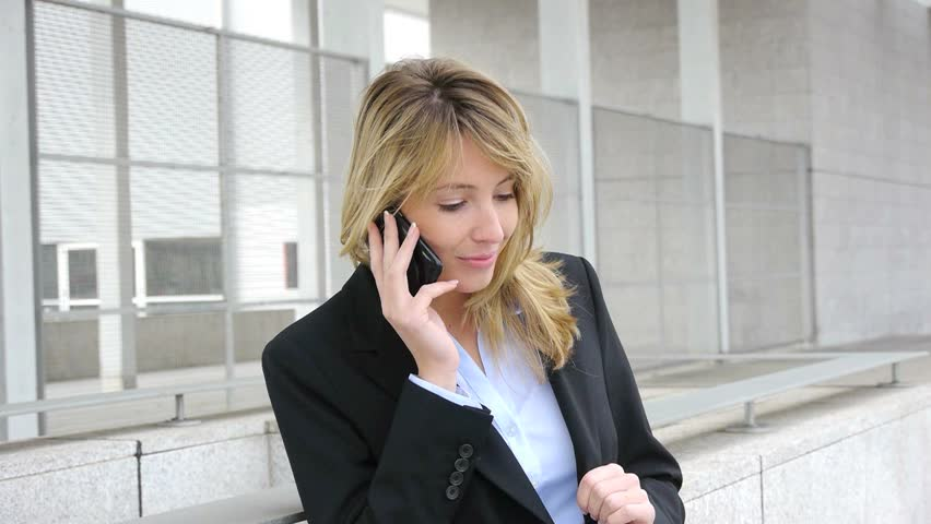 Businesswoman talking on the phone - HD stock footage clip