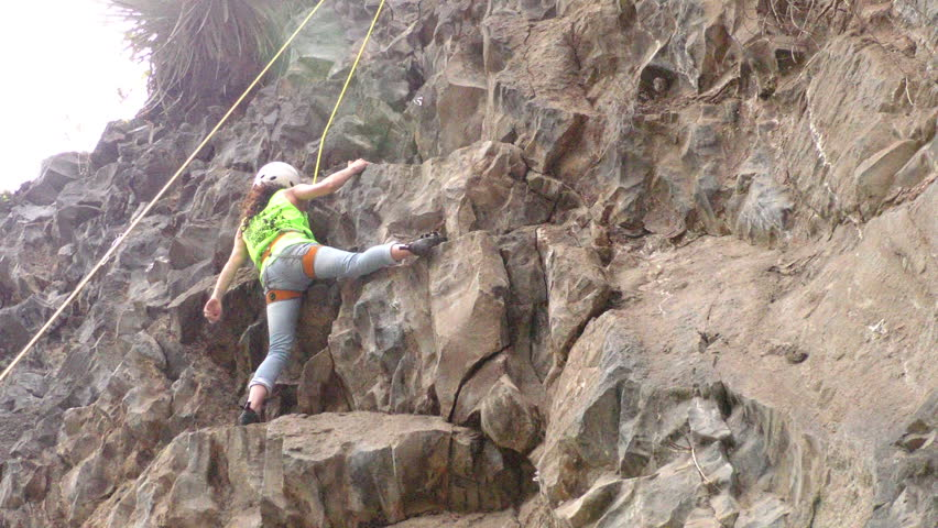 Banos, Ecuador - 30 May 2015: Young Unidentified Woman Tries For The First Time Rock Climbing At Basalt Of Tungurahua Competition In Banos On May 30, 2015  - HD stock footage clip