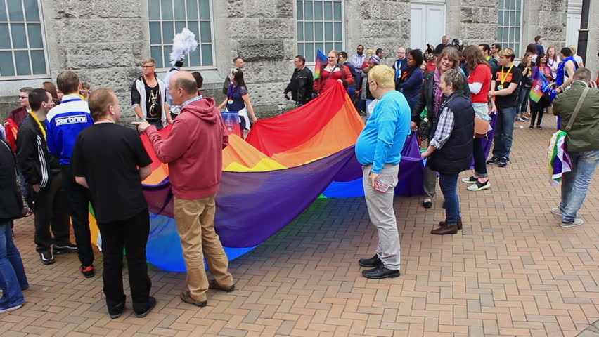 People holding a huge rainbow flag/banner on Victoria Square 2 -  Birmingham Gay Pride, England 2015