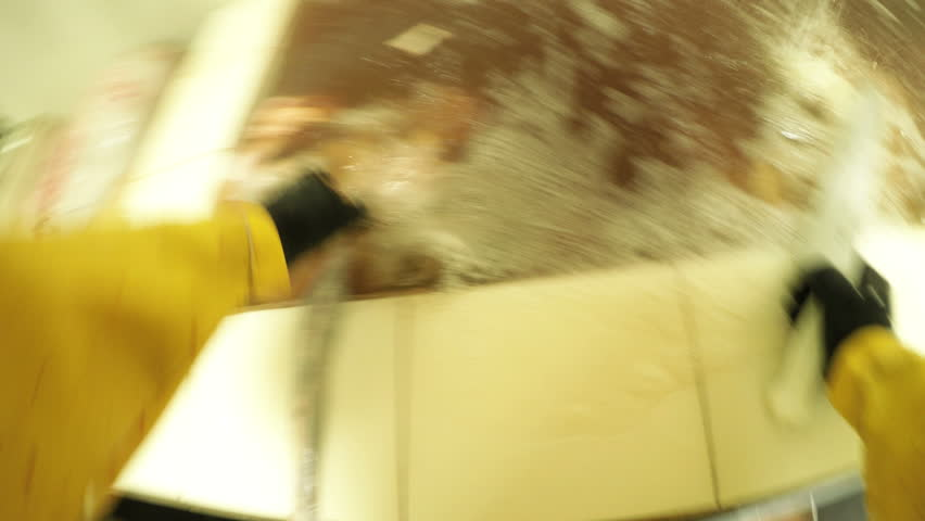 First person point of view of a slaughterhouse worker washing and separating internal organs and animal intestines