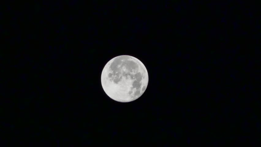 Blue Full Moon with passing clouds, Real Time. Blue Moon in night sky on August 1, 2015 in Istanbul. Blue Moon is the third full moon in a season with four full moons