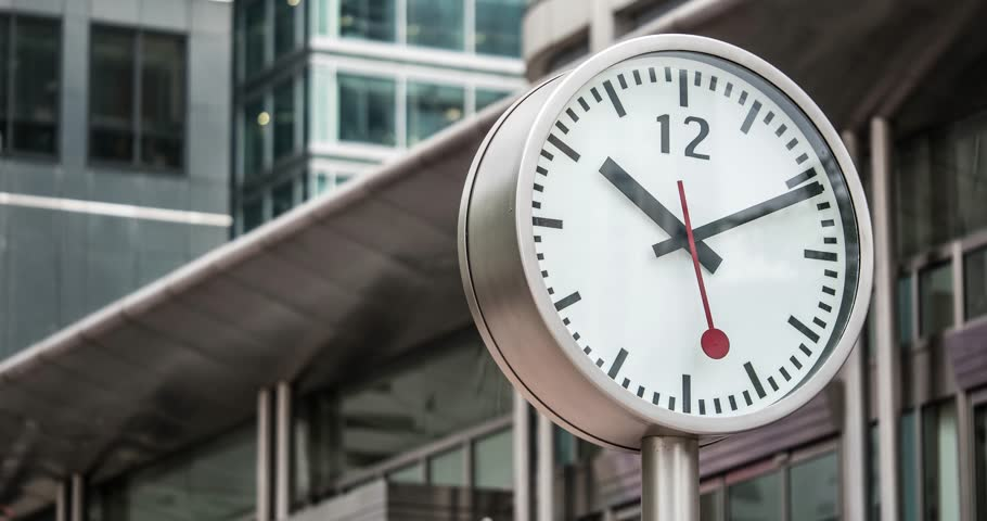 TIME LAPSE: Canary Wharf clock detail. Canary Wharf is a major business district with around 14,000,000 square feet of office and retail space.  | Shutterstock HD Video #11033108