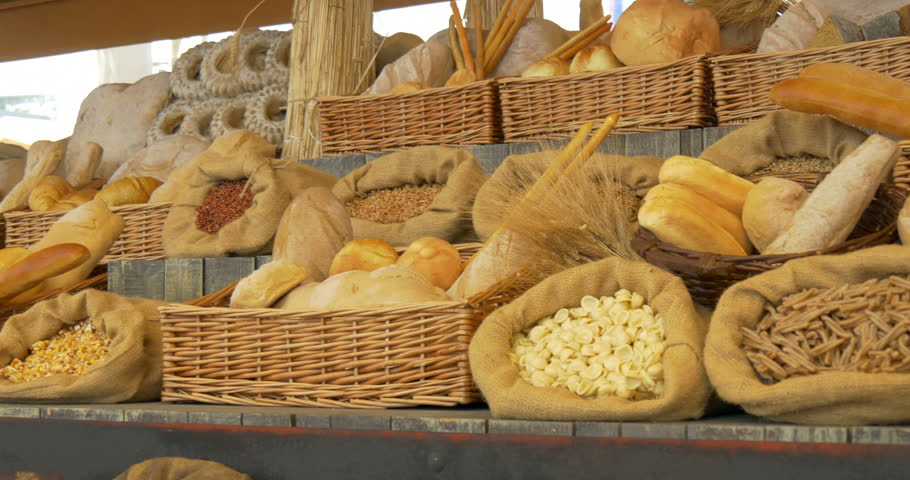 Bread and pasta on wooden shelf of a bakery
