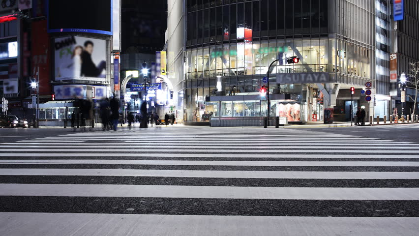 Time lapse footage with zoom out motion of famous crosswalk at dawn in Shibuya, Tokyo, Japan