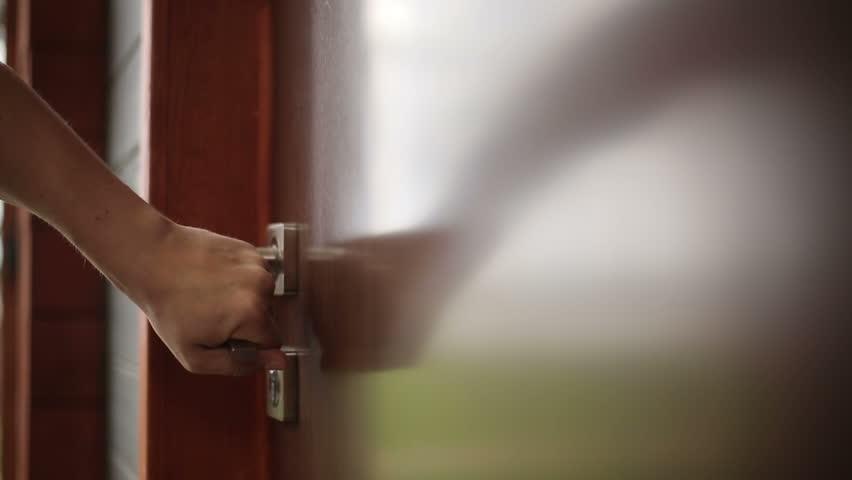 Someone opens door close up