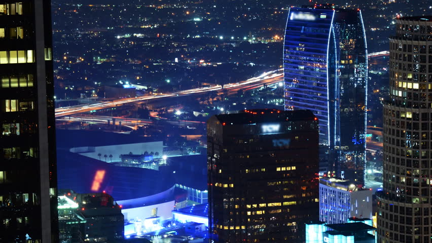Time lapse footage with zoom out motion of LA LIVE - entertainment center in downtown Los Angeles at night during Earth Hour, the global energy conservation event in 2015