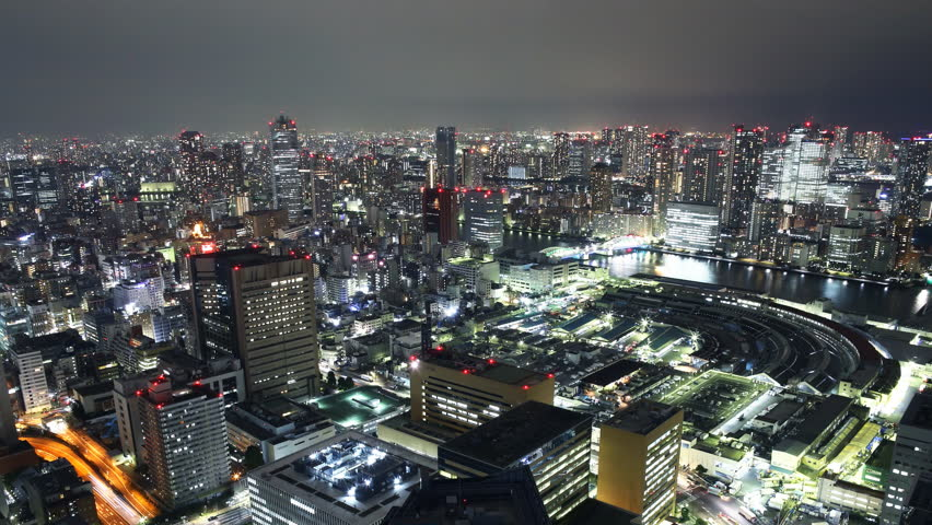 Time lapse footage with tilt down motion of Tsukiji Fish Market district at night in Tokyo, Japan