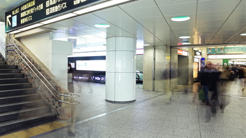TOKYO, JAPAN -February 27th, 2015: Motion controlled pan right time lapse footage of rush hour commuters at Shinjuku Station in Tokyo, Japan