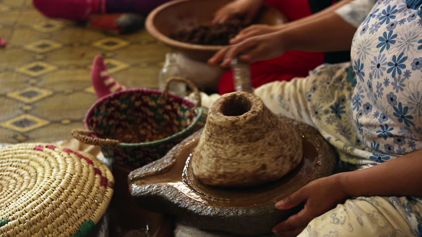 Berber woman produce Argan oil in a traditional way in Morocco.They crack Argan hard-shelled nut which is collected from the Argan trees.Argan oil is used for cosmetics,hair styling and skin health