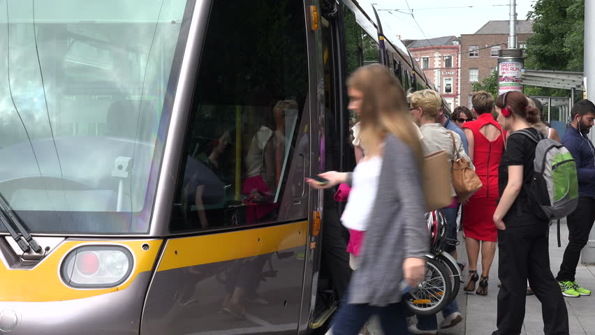 DUBLIN, LEINSTER/IRELAND - JULY 15, 2015: Unidentified passengers board the Dublin tram at St Stephens Green. Luas is a tram light rail system which in 2014 carried 32.4 million passengers.