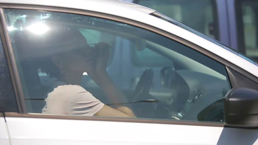 Young woman doing make up in car - HD stock footage clip