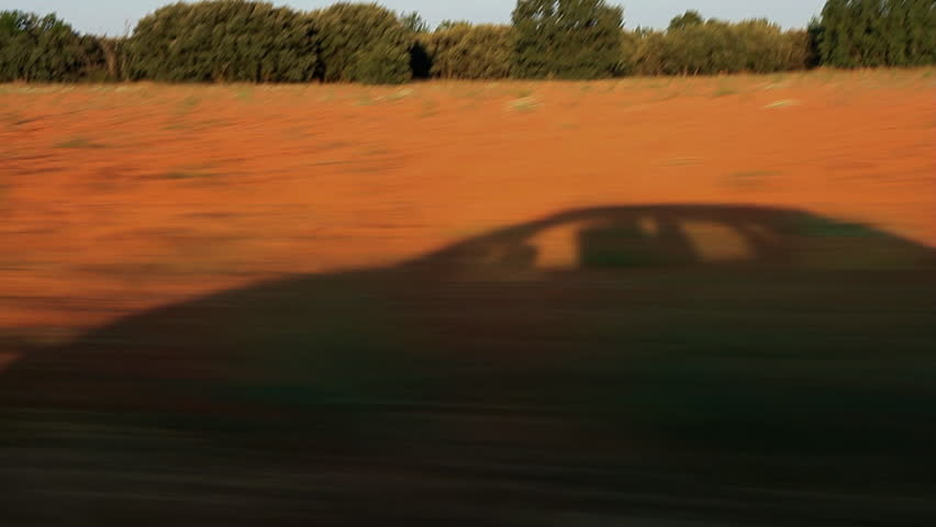 Traveling Tracking Shadow of a Car in Summer Landscape -  