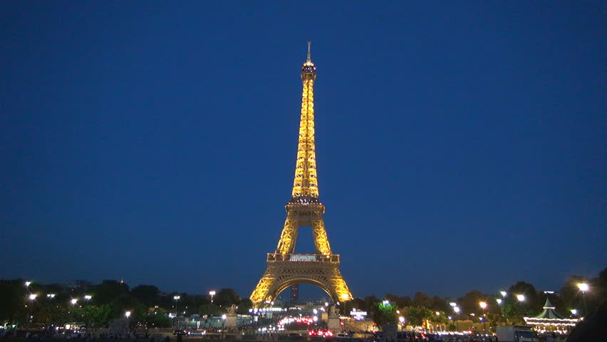 paris france january 2 people look at night eiffel tower with rotating search lights on. Black Bedroom Furniture Sets. Home Design Ideas