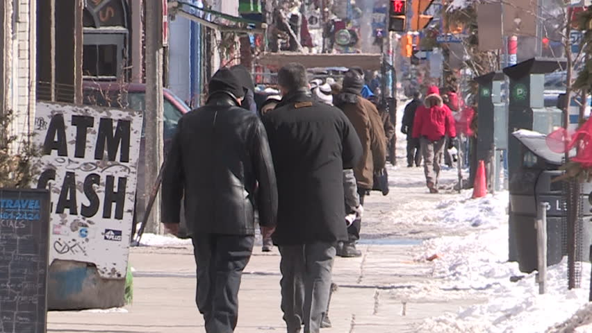 Toronto, Ontario, Canada December 2013 Busy streets people traffic congestion in downtown Toronto on winter day.