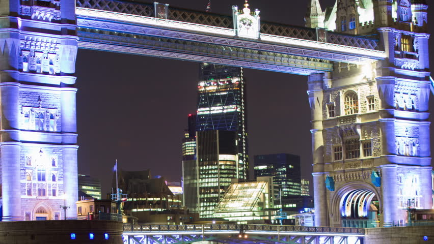 night time timelapse shot of tower bridge lit up in purple light in london - HD stock footage clip