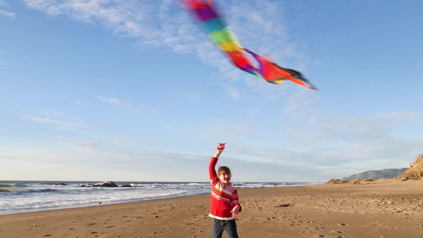 Girl flying kite at beach   Shutterstock HD Video #11283434