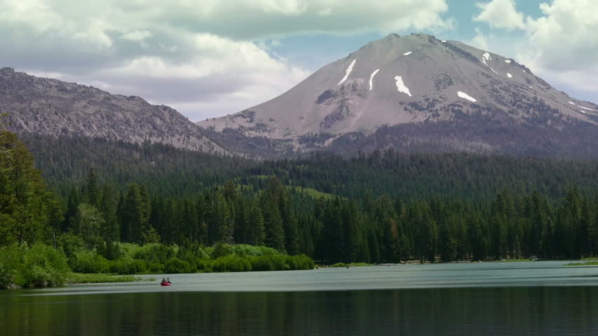 Lassen Volcanic National Park, California, United States of America  July, 2015: Two people paddle a Kayak on Manzanita Lake with Lassen Peak in the background.