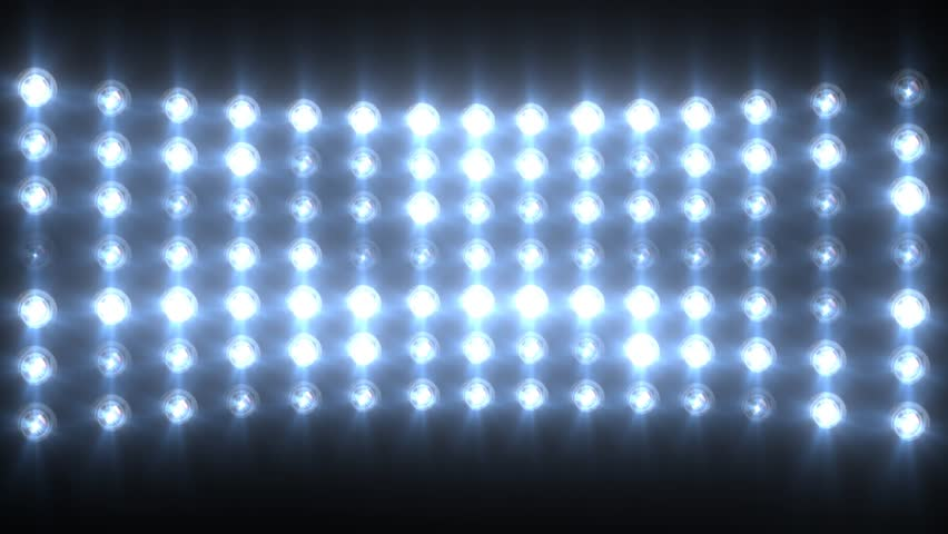 Stage, Concert Or Stadium Lights Flashing. Warm Colors