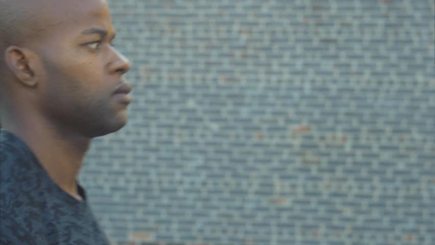 Cinematic close up of black male athlete preparing before training - 4K stock video clip