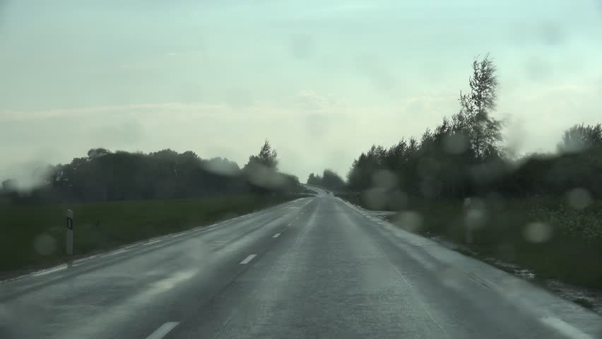 Drive car on rainy road bad weather conditions. Front window view. 4K - 4K stock video clip