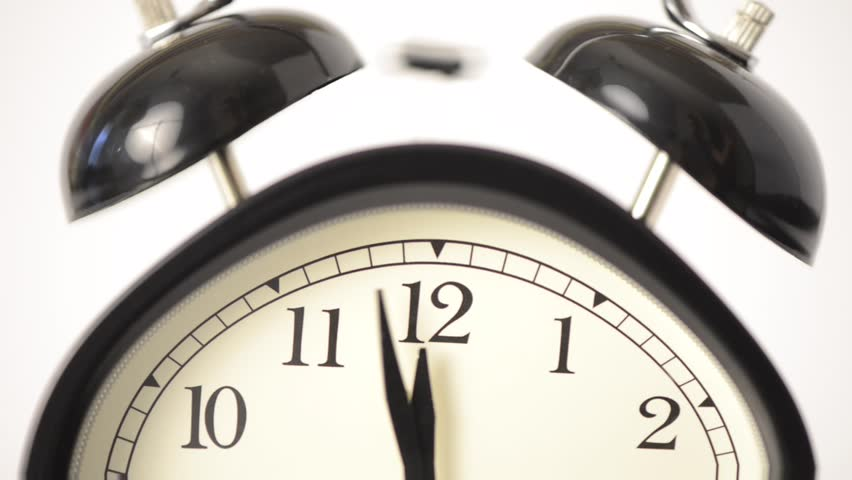 Close-up of ringing alarm clock. It is wobbling and moving with a psychedelic effect.