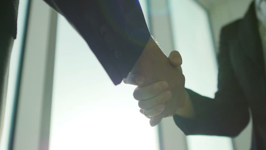 Two business partner shake hands when meeting. In slow motion | Shutterstock HD Video #11397464