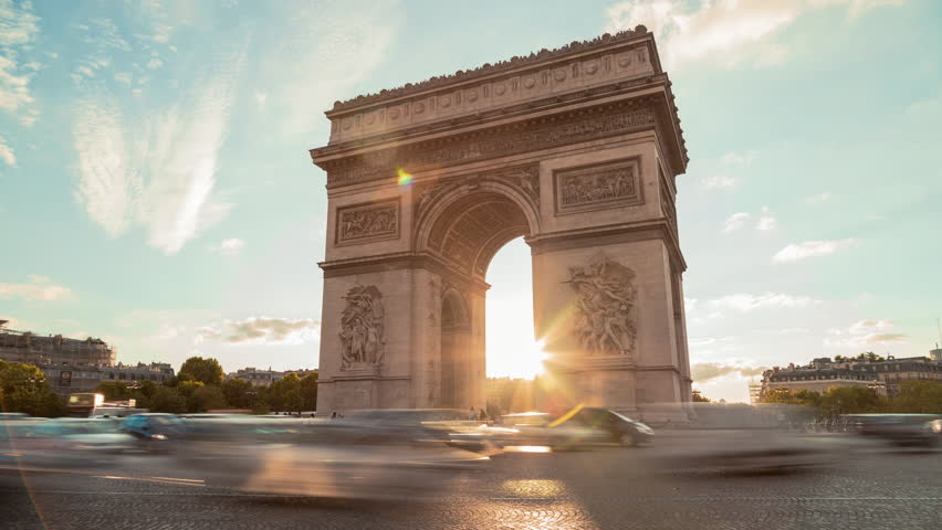 Arch Of Triumph, Evening, Paris - Time LapseA Time Lapse of The Arch of Triumph (Arc de Triomphe) in the evening, with cars and buses passing by in motion blur. 0h15 Time Lapse