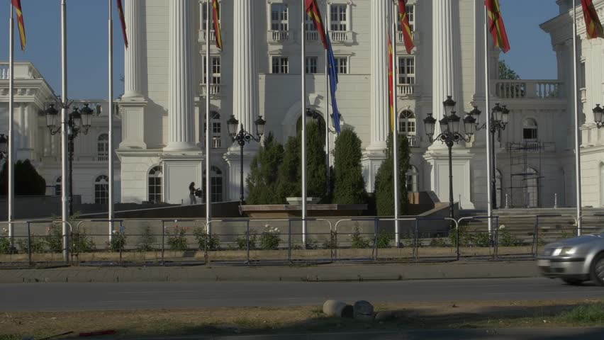 SKOPJE, MACEDONIA - JULY 17, 2015: Paning to the top of the government building in state capitol. - 4K stock footage clip