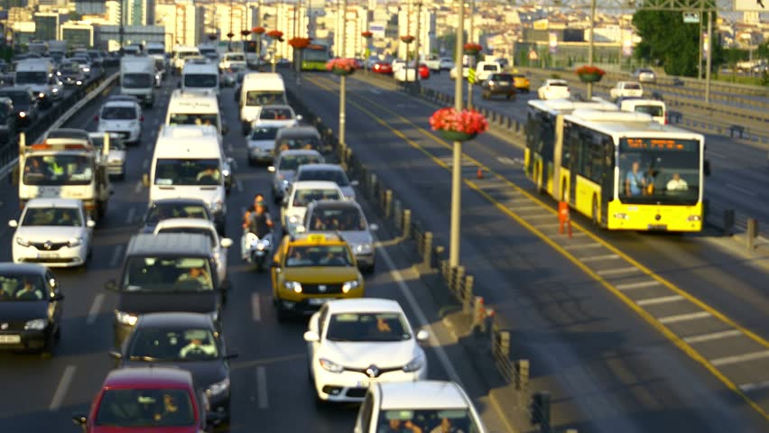 Traffic on the busiest highway E-5 in city. Out of focus. Traffic congestion is diminishing the quality of life in Istanbul. Currently almost 1.8 million automobiles choke its roads.