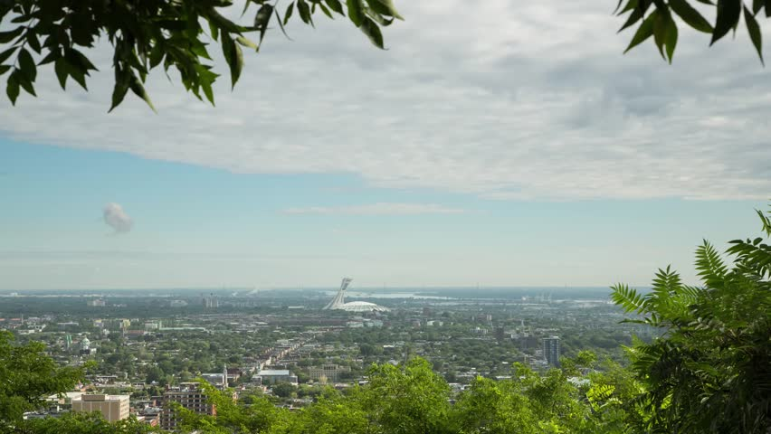Montreal, Canada - August 2015. A Time lapse taken from Mont Royal overlooking the East end of Montreal and the Olympic Stadium. | Shutterstock HD Video #11593817