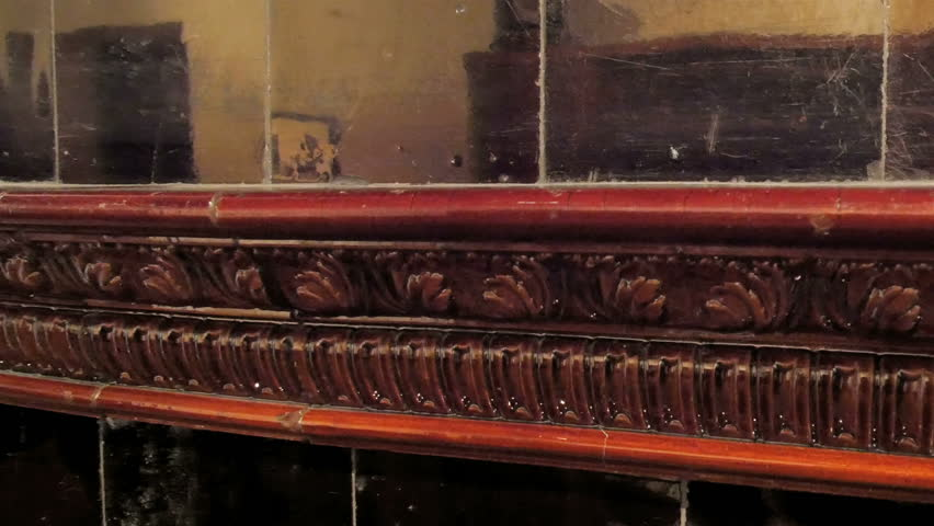 A mantelpiece on the table of the house. It has very detailed carvings on the side - 4K stock video clip