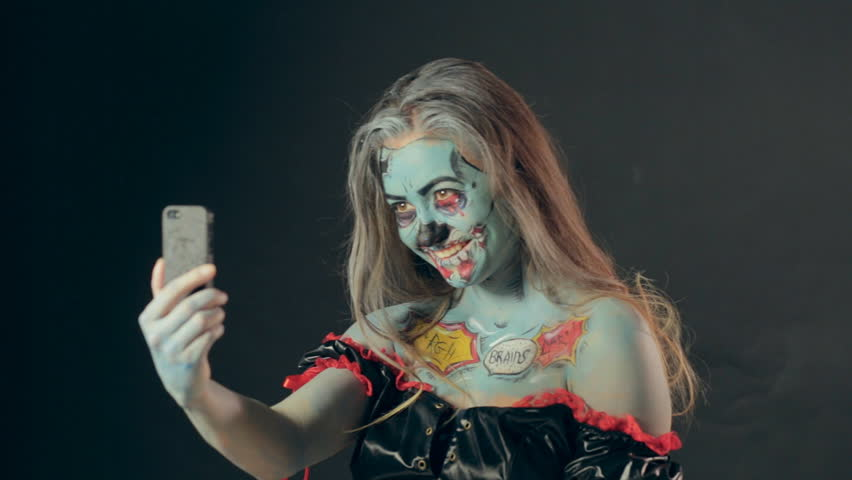The girl in a black cloak in the hands holding a mirror for Mirror zombie girl