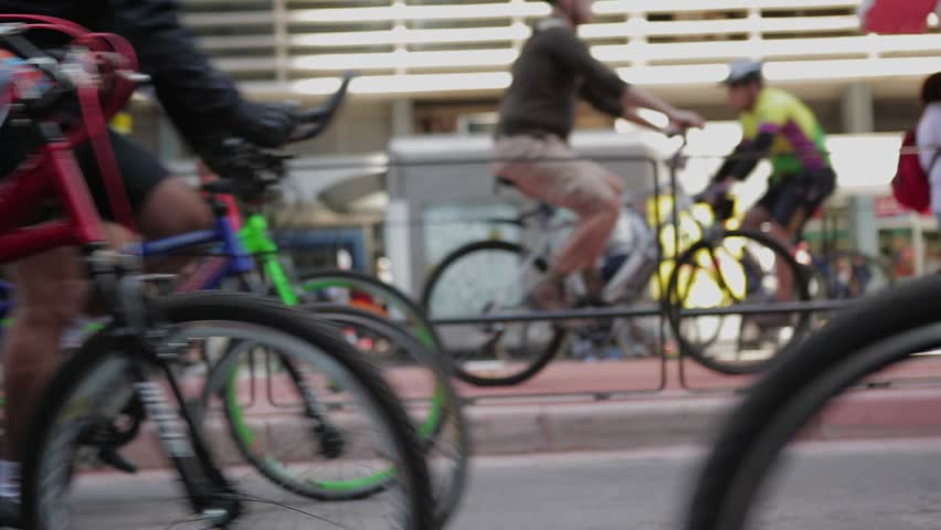 Crowds of people riding bikes in large city avenue. Green environmental movement. Commuters going to work by bicycling to work. | Shutterstock HD Video #11642660