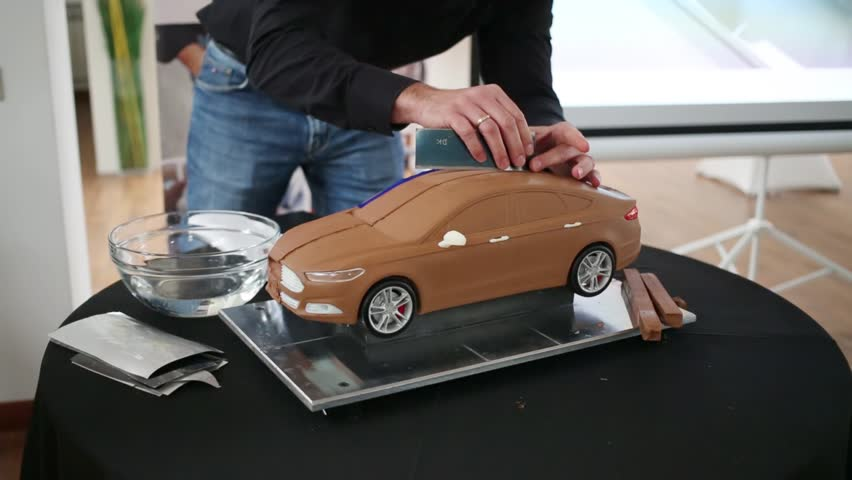 moscow russia december 4 2014 man shows how to make a clay model of the car at the press. Black Bedroom Furniture Sets. Home Design Ideas