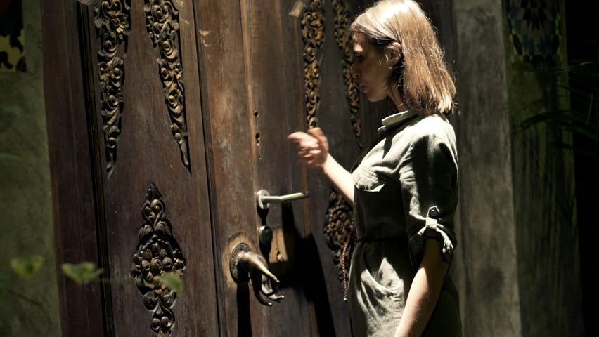 Girl Walks Into Door : Young woman knock with hand at enter door of her house