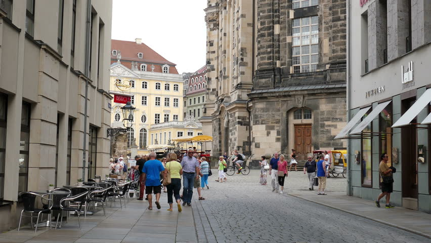 DRESDEN, GERMANY - JULY 2015: Street in the old town and Frauenkirche in the background. - 4K stock video clip